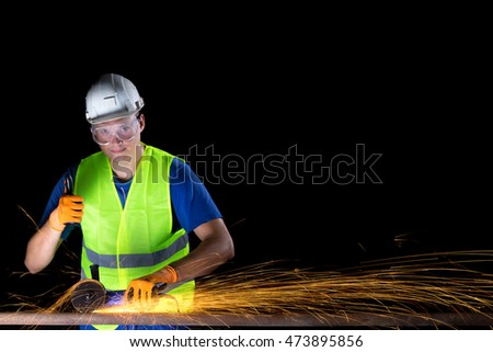 worker with angle grinder