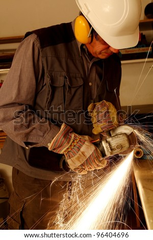 Worker with angle grinder - stock photo