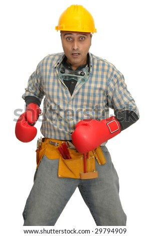 worker with boxing gloves isolated in white - stock photo