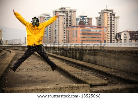 Worker with gas mask jumping - stock photo