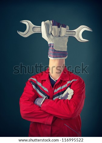 Worker with hand holding spanner instead of head - stock photo