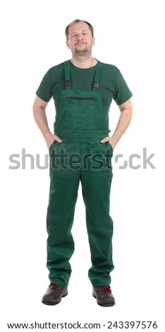 Worker with hands in pockets. Isolated on a white background. - stock photo