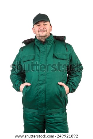 Worker with hands in pockets. Isolated on a white background.