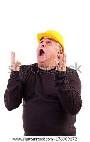 Worker with hard hat screaming isolated on white background - stock photo