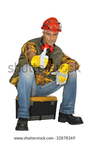 Worker with hat seated in a  tool box isolated in white - stock photo