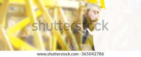 Worker with protective helmet in front of construction site - Double exposure - stock photo
