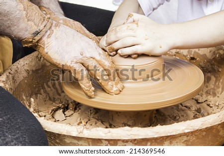 Worker with shaping clay objects, profession and business - stock photo