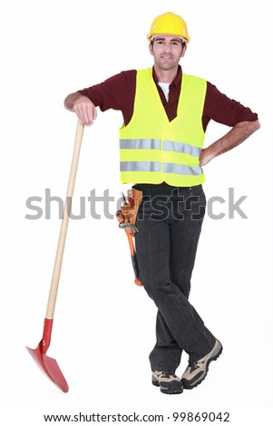 Worker with spade - stock photo