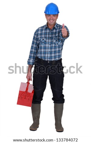 Worker with thumbs-up - stock photo