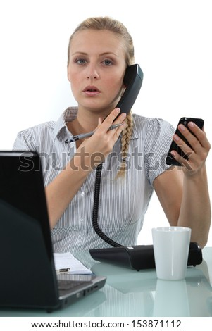 Worker with two phones