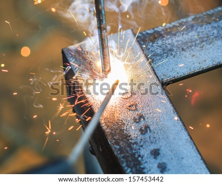 worker with welding metal and sparks  welding with sparks  - stock photo