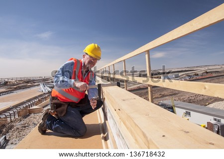 worker working at construction site - stock photo