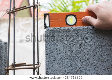Worker Working Bricklaying brick wall - stock photo