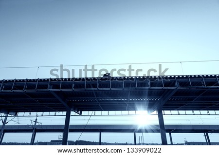 worker working on roof - stock photo