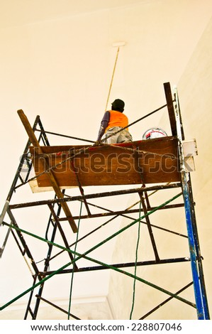 worker working on scaffold - stock photo