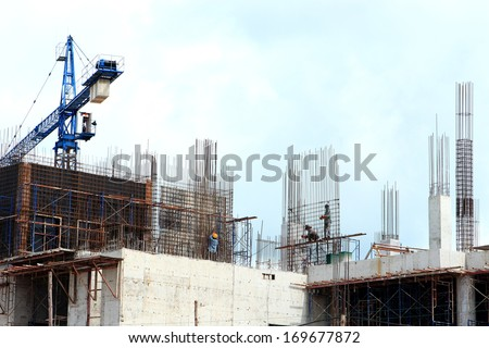 worker working with crane on construction site - stock photo