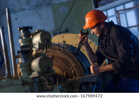 worker works on the repair plant - stock photo