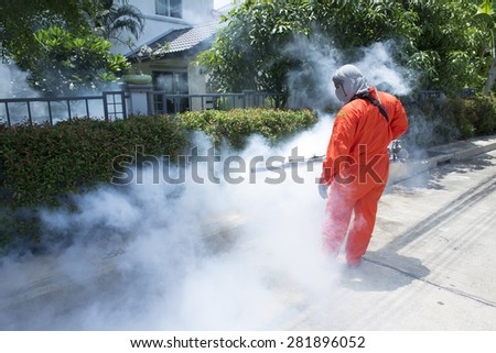 Workers are fogging for dengue control. - stock photo