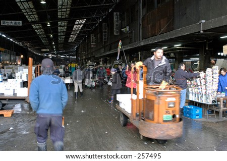 Workers at entrance to Tsukiji fish market, Tokyo, Japan
