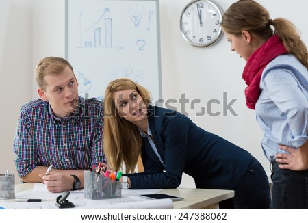 Workers at office having argument at workplace - stock photo