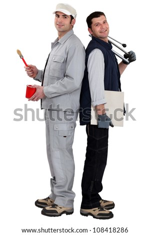 Workers back to back - stock photo