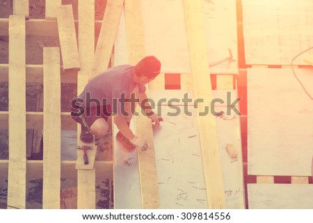 Workers building roof - stock photo