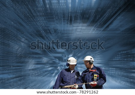 workers, engineers, set against giant motherboard, dash-board, background in slight zoom effect - stock photo
