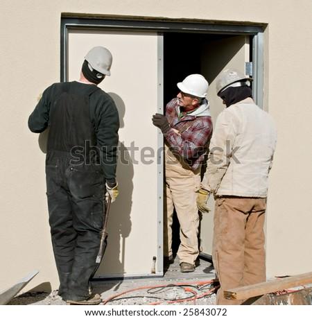 Workers Fixing Door & Door Fixing Men Stock Photos Royalty-Free Images \u0026 Vectors ... Pezcame.Com