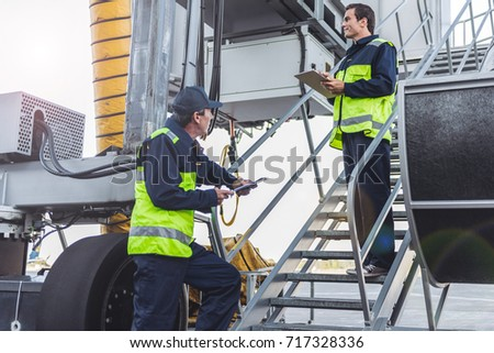 Workers having job at airport