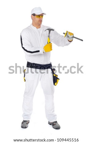 workers in white overalls working with hammer and chisel on a white background - stock photo