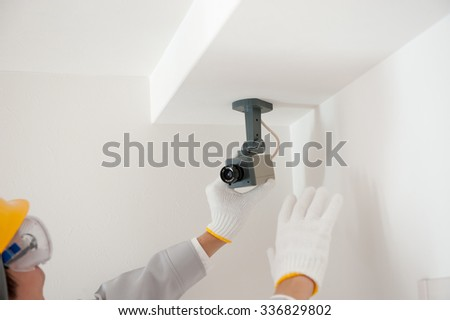 Workers installing a security camera