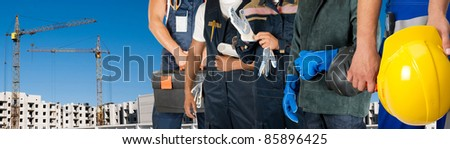 workers man on building background - stock photo