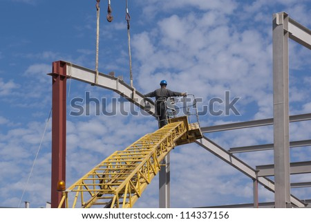 Workers mounted skeleton of the building - stock photo