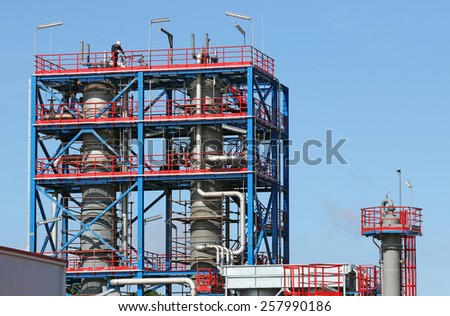 workers on new petrochemical plant construction site - stock photo