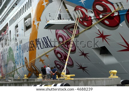 workers prepair for departure of a  cruise ship in seattles puget sound - stock photo