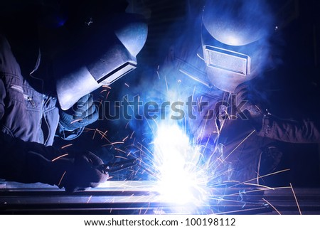 Workers weld the metal. Construction and production - stock photo