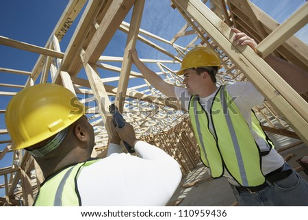 Workers working in framework at a construction site