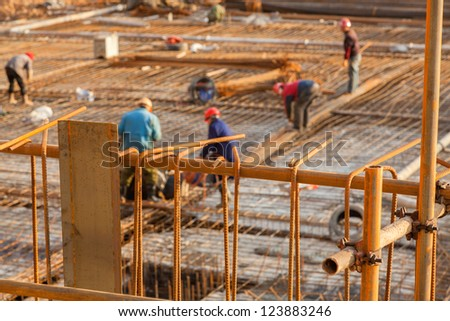 workers working with concrete irons in a construction site - stock photo
