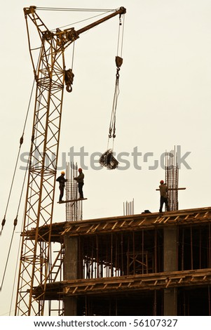 Working against the backdrop of new construction. Construction of new buildings. The work of the crane. Industry - stock photo
