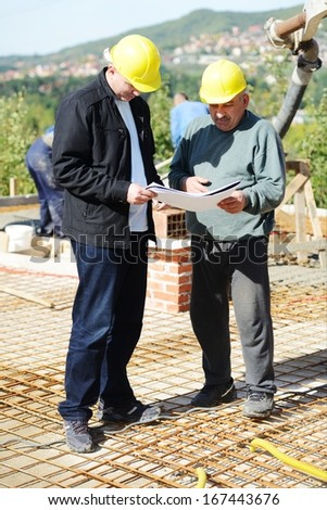 Working and building on new house project - stock photo
