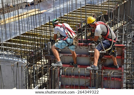 Working at the construction site - stock photo
