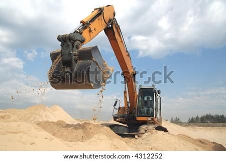 Working backhoe - stock photo