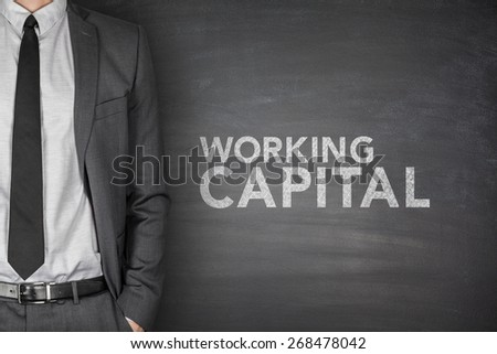 Working capital on black blackboard with businessman - stock photo