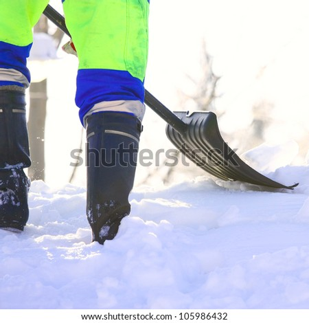 Working cleans the road from snow - stock photo