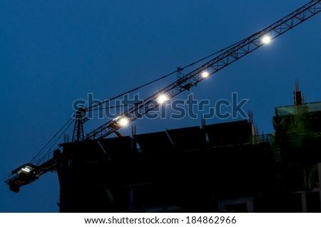 working crane at night - stock photo