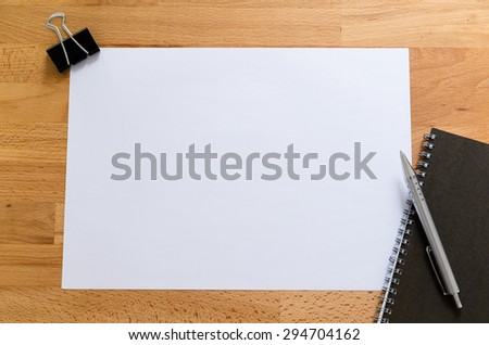 Working desk with plain paper for adding some information - stock photo