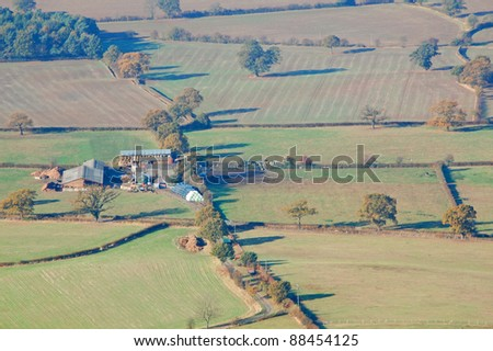 working farm in the english countryside - stock photo