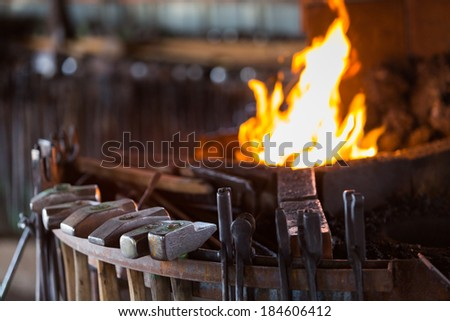 Working forge of the blacksmith in old shop. - stock photo