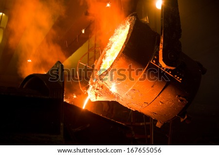 Working in a foundry. Shallow doff. See more images and video from this series. - stock photo