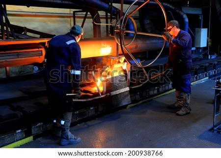 Working in a foundry, Stara Zagora, Bulgaria, February 11, 2014 - stock photo